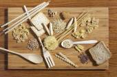 Art composition of pasta, grains,  whole grain bread, wooden kit — Stock Photo