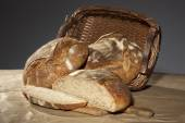 Big basket with traditional ecological homemade bread — Stock Photo