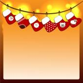 Christmas stockings on a rope — Stock Vector