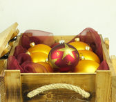 Christmas balls in a wooden box. — Stock Photo
