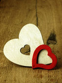 Heart's on a wooden boards background. — Stockfoto