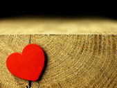 Red heart on the edge of a wooden table. — Zdjęcie stockowe