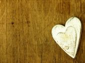 Wooden heart on the oak table. — Stock Photo