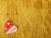 Wooden heart on the oak table. — Stock Photo