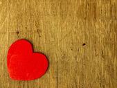 Wooden heart on the oak table. — Stockfoto