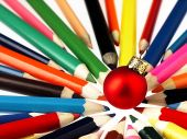 Colorful wooden crayons and Christmas Tree Bauble. — Stockfoto
