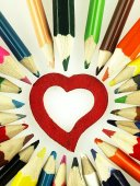 Colorful wooden crayons and red Heart. — Stock Photo