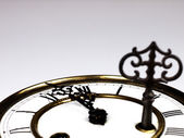 Old clock with roman numerals and key.. — Stock Photo
