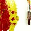 Color traces and brush on a white sheet of paper. — Stock Photo #62777861