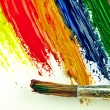 Color traces and brush on a white sheet of paper. — Stock Photo #62777959