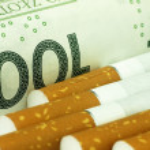 Cigarettes and money. Expensive habit. — Stock Photo #63270971