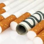 Cigarettes and money. Expensive habit. — Stock Photo #63270977