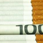 Cigarettes and money. Expensive habit. — Stock Photo #63270989