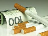 Cigarettes and money. Expensive habit. — Stockfoto