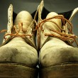 Постер, плакат: Pair of old worn heavy boots
