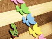 Colorful cut tulips and duck on a chopping board. — Stock Photo