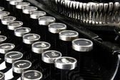 Old, dusty typewriter seen up close. — Stock Photo