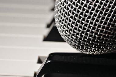 Microphone on a piano keyboard.
