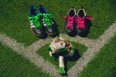 Boots on the football field — Stock Photo