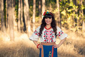 Ukrainian woman in national  clothes on the wheat field — Stock Photo