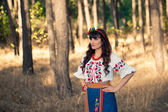 Young woman in national ukrainian clothes on the wheat field — Stock Photo