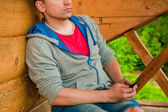 Young man using mobile phone. Mountains. Communication concept. — Stock Photo
