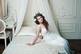 Beautiful brunette curly bride — Stock Photo