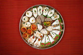 Indian sweets in plate — Foto Stock
