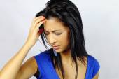 Young woman with a headache — Stock Photo