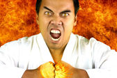 Karateka who expresses anger — Stock Photo