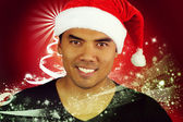 Young Filipino with a hat of Santa Claus — Stock Photo