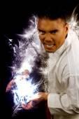 Man in a kimono making a fireball — Stock Photo