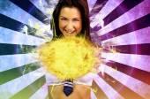 Sexy schoolgirl making a fireball — Stock Photo
