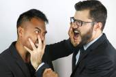Two young businessmen fighting — Stock Photo
