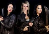 Three women rebels dressed leather — Stock Photo