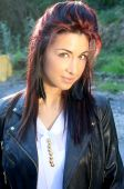 Beautiful woman with red streaks in her hair — Foto Stock