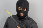 Terrorist with a pencil in his weapon — Stock Photo
