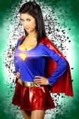 Beautiful brunette woman dressed as a super hero — Foto Stock