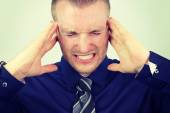 Businessman with a headache — Stock Photo