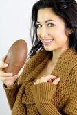 Beautiful brunette holding an easter egg — Stock Photo