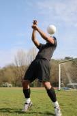 Football player juggling — Stock Photo