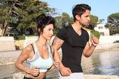 Couple running on the beach — Stock Photo
