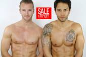 Two sexy men on sale — Stock Photo
