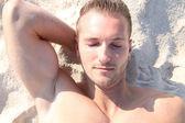 Sunbathing at the beach — Stock Photo