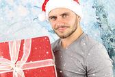 The christmas season- young man smiling — Stock Photo