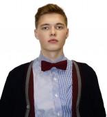 Mužský model ve svetru s motýlkem — Stock fotografie