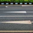 3 Arrow sign on asphalt surface — Stock Photo #54887453