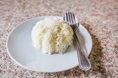 Rice in white dish with silverwar — Stock Photo