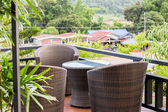Rattan armchair and table on mountain view terrace — Stock Photo