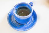 Tea in blue cup — Stock Photo